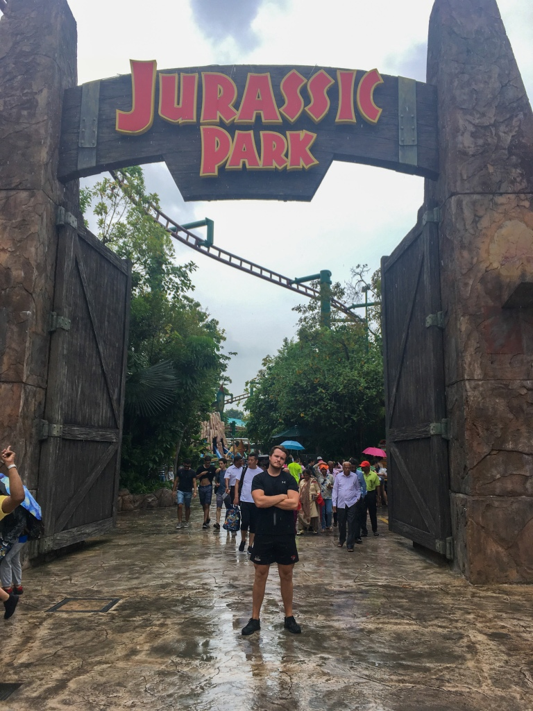 Two Days In Singapore - Shaun Stood with Jurassic Park Sign